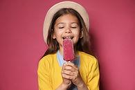 Girl Eating Popsicle