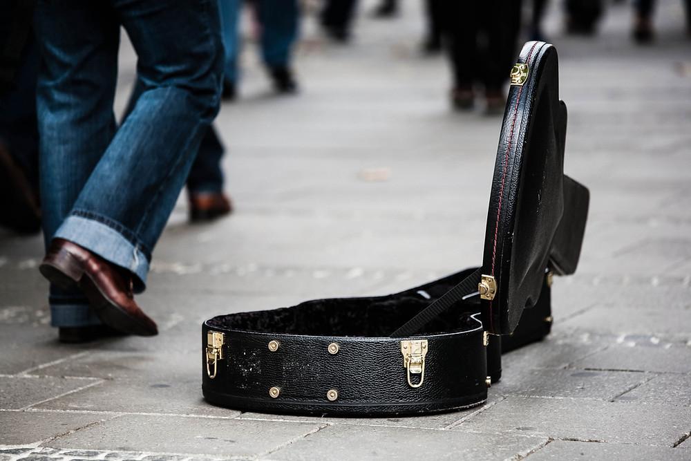 Guitar case for street performer, Side hustle