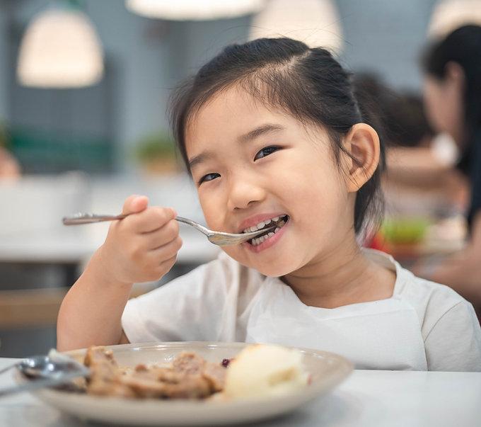 Kid Eating Meal