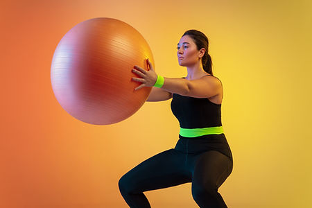woman working out with Fit Ball