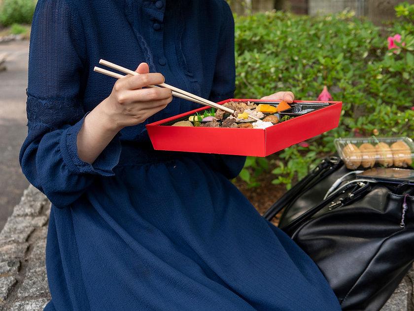 Woman with Bento Box