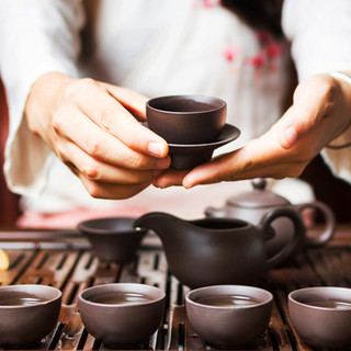 Serving wellness tea from parenteaing