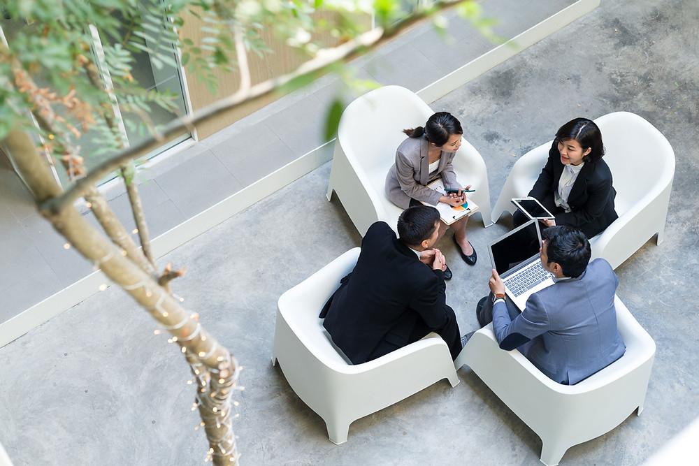 people negotiating in a meeting