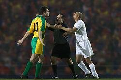 Referee Breaking up Dispute
