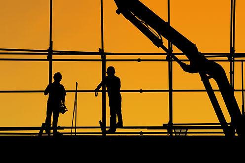Silhueta de trabalhadores da construção