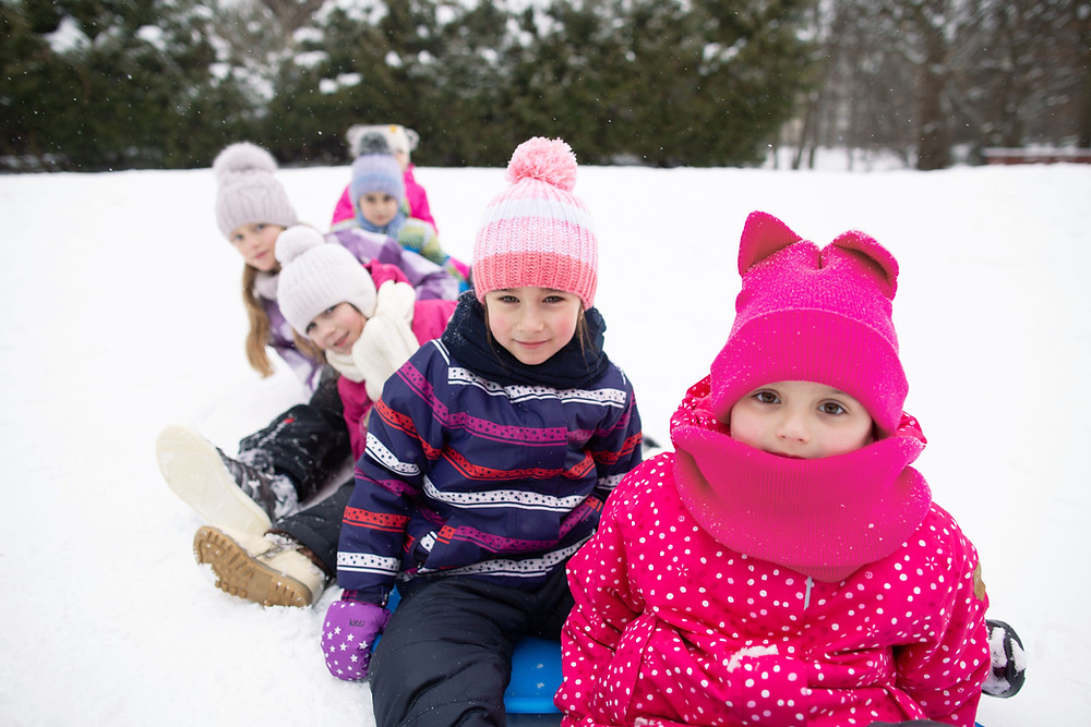 Kids in cold snow dressed warm
