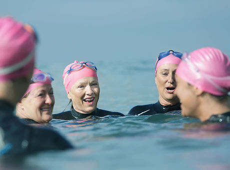 Swimmers talking in the sea