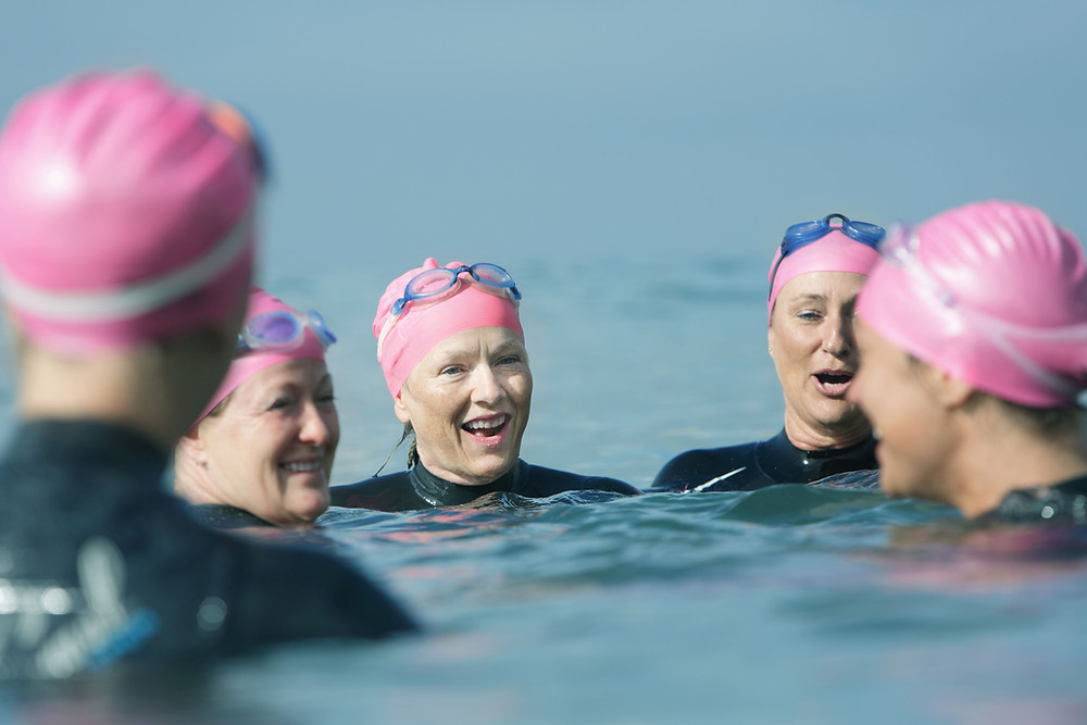 Female Triathletes In Open Water Getting Ready to Swim