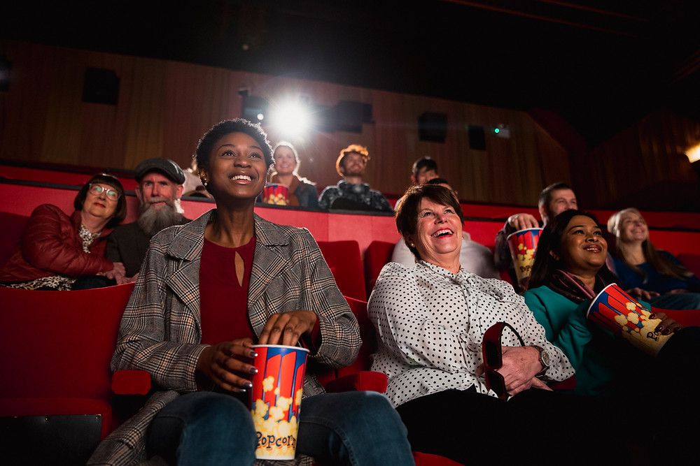 People laughing in a movie theater