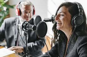 A Man and a woman participating in a radio show