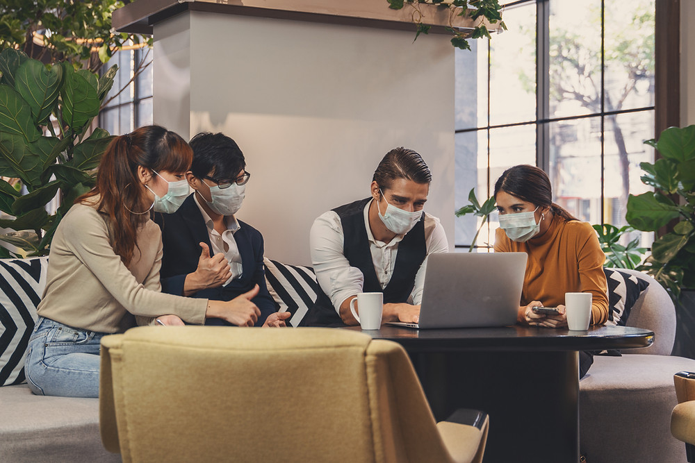 office meeting with colleagues wearing face masks