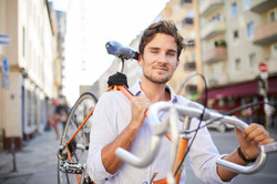 man holding a bicycle on his shoulders