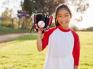 Girl Holding Baseball