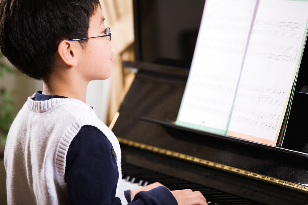Does Learning Piano Make You Faster At Typing? | Melodious Piano Studio Singapore