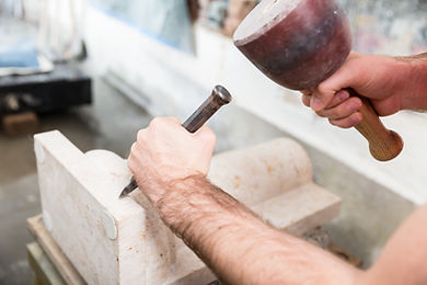 Stone Carver at Work Stonemasonry project in Bath, England. Carving out Bath stone