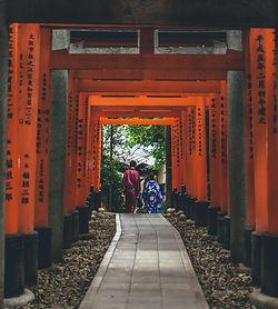 People Walking Through Shrine