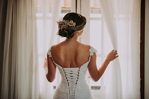 Photo of Back of Bride In Wedding Dress