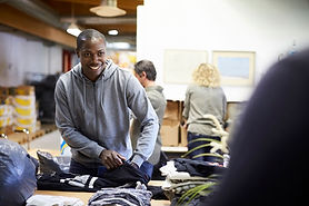 Picture of a man folding clothes