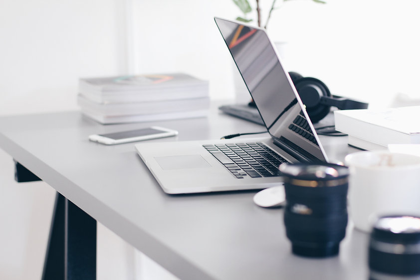 Desk with Laptop and poor ergonomics set-up which leads to back pain and 'Tech Neck'