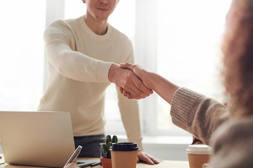 Handshake between two individuals