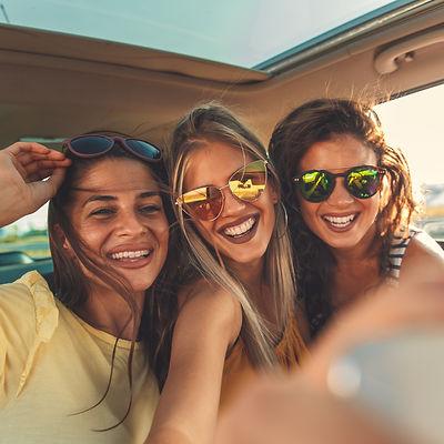 Smiling Girls in Car
