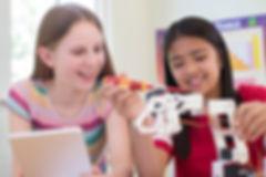 Girls Building Robot