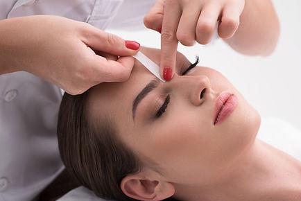 Woman having her eyebrows waxed