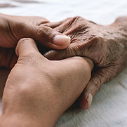 Holding hands with geriatric care management patient