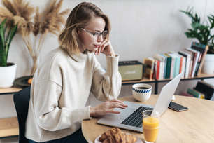 Woman works on the computer