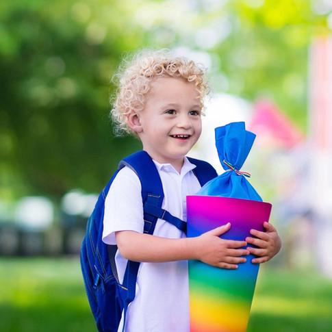 Boy Holding a School Cone