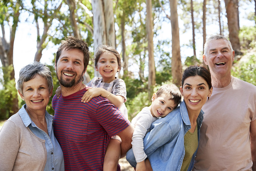 Family outside manufactured home Paradise Homes