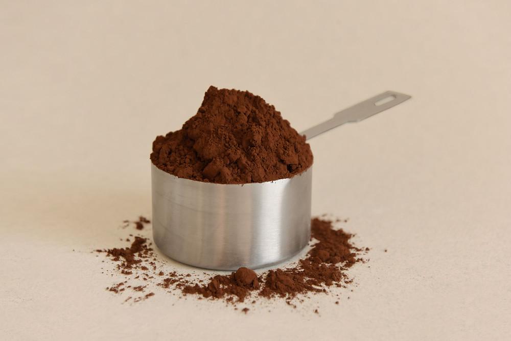 Cocoa powder in a measuring cup