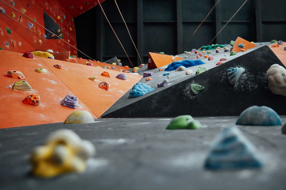 Looking up along the side of a climbing wall.
