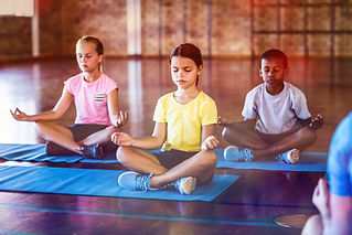 Children Meditating during Kind Karma Yoga Class
