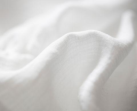 Tissu de coton blanc