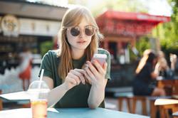 Texting at Cafe