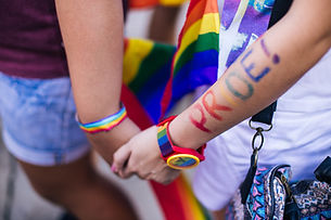 Two people holding hands at Pride