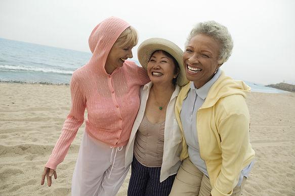 Women Laughing on Beach
