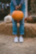 Farmer Holding Pumpkin