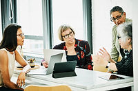 A group of women at a business meeting