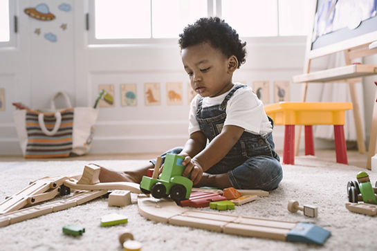 Kid Playing with Wooden Toys