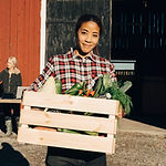 Woman with Crate of Vegetables