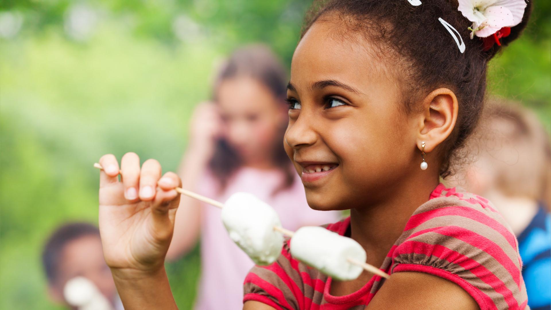 Girl Eating Marshmallows