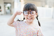 Small Child with Large Glasses