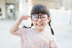 Small Child with Large Glasses, Focus on Vision Program