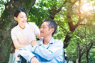 Senior Patient In Wheelchair And Caregiver