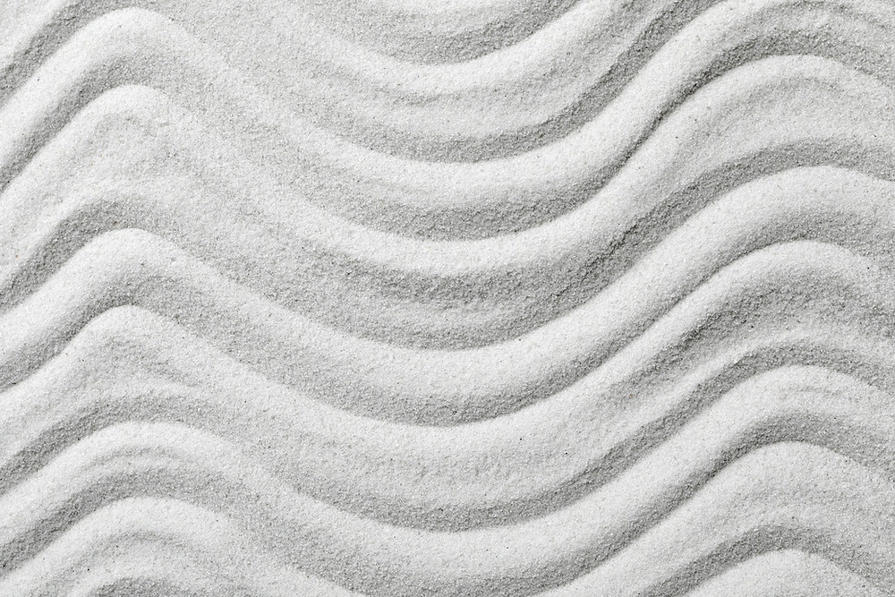 Rough grooves drawn into white sand