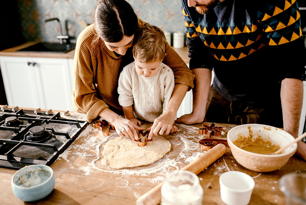 Mom, dad and child cooking together