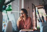 Pensive Freelancer working remotely