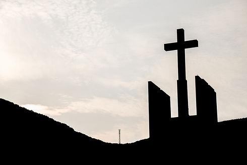 Silhouette Of Cross Against Sky